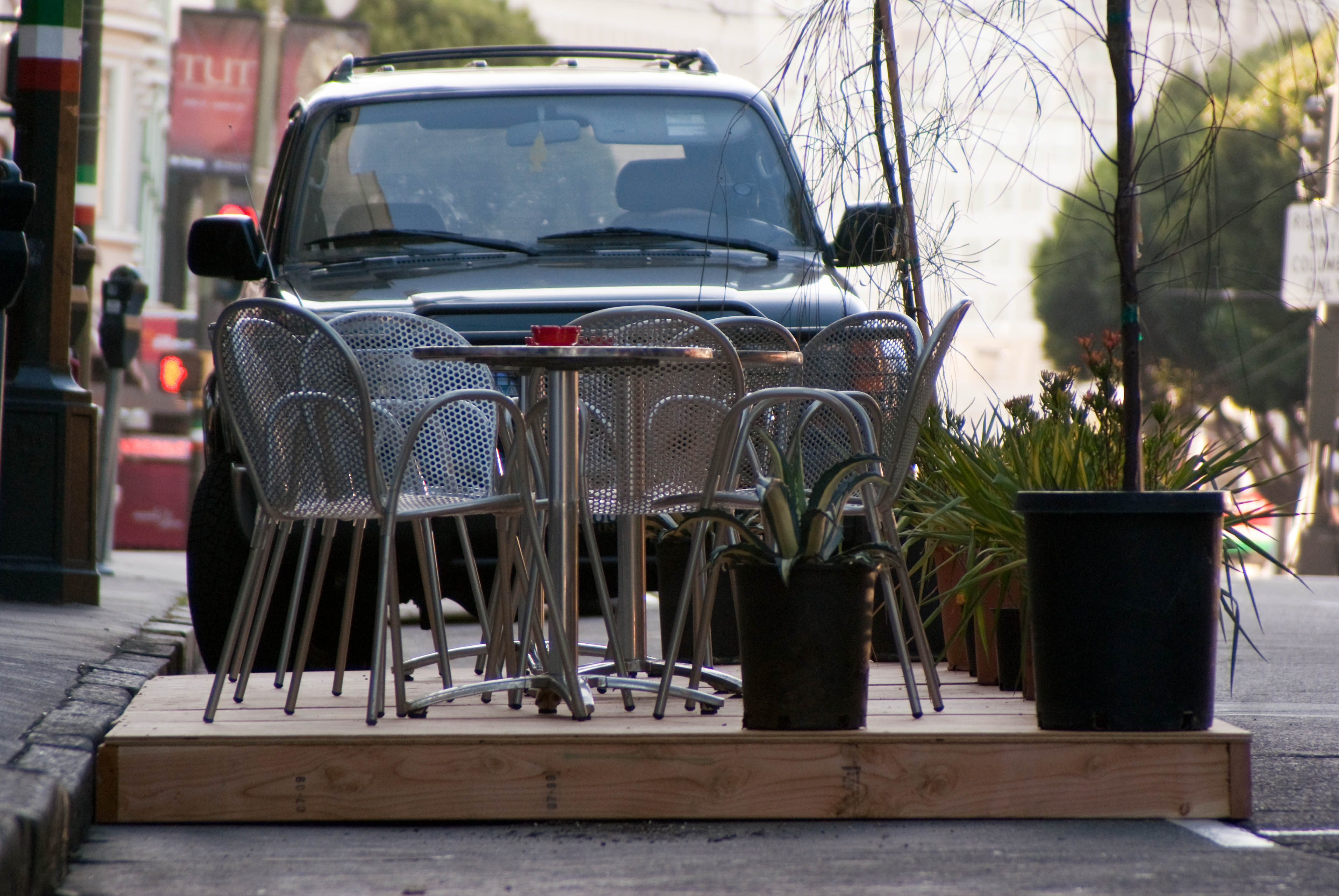 09377 Seating for nine at Caffe Roma Park(ing) Day spot in front of seating for four